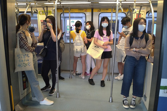Passengers wear face masks to protect against the spread of the coronavirus at a train in Taipei, Taiwan, Saturday, June 27, 2020. (Photo by Chiang Ying-ying/AP Photo)