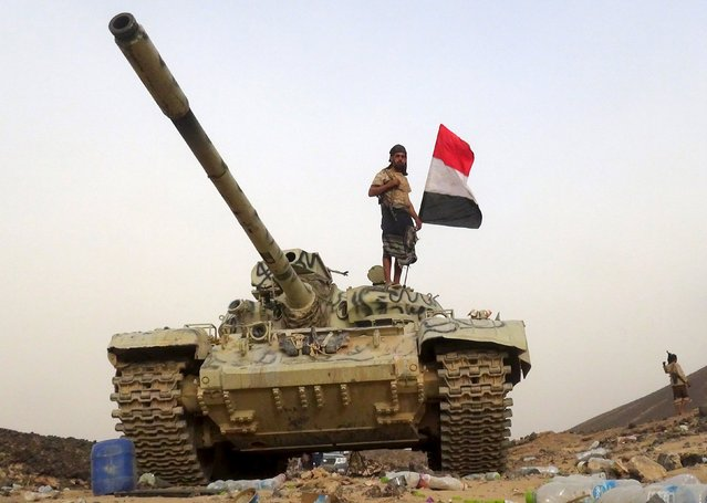 A soldier loyal to Yemen's government rides on a tank in the frontline province of Marib, September 19, 2015. Picture taken September 19, 2015. (Photo by Reuters/Stringer)
