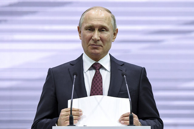 Russian President Vladimir Putin pauses as he speaks, at the 3rd Railway Congress in Moscow in Moscow, Russia, Wednesday, November 29, 2017. Putin spoke to railway workers about the industry problems and voiced hoped that Russian Railways will work well to serve visitors of the World Cup in Russia next year. (Photo by Yuri Kadobnov/Pool Photo via AP Photo)