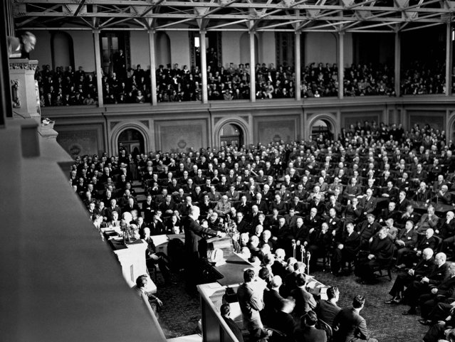 "Congressmen, cabinet members, Supreme Court justices, and others  listen as a grim President Franklin D. Roosevelt asks for war against Japan: ""With confidence in our armed forces – with the unbounding determination of our people – we will gain the inevitable triumph - so help us, God"".  President Roosevelt spoke in the House of Representatives, addressing a joint session of Congress, December 8, 1941. (Photo by Associated Press)"