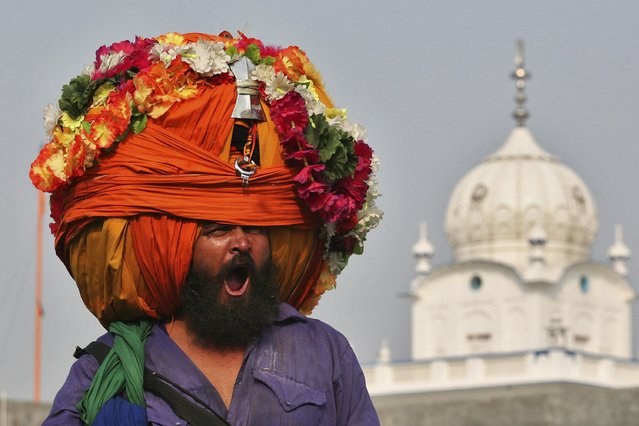 A Nihang or a Sikh warrior, yawns while wearing a turban during a religious procession to mark the Bandi Chhorh Divas in the northern Indian city of Amritsar October 24, 2014. Sikhs celebrate Bandi Chhorh Divas a day after Diwali to mark the return of the Sixth Guru, Guru Hargobind Ji, who was freed from imprisonment from the fort of Gwalior by Mughal Emperor Jahangir in October 1619. (Photo by Munish Sharma/Reuters)