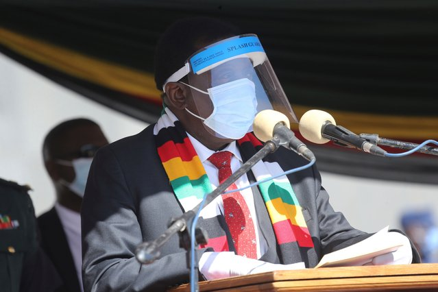 Zimbabwean President Emmerson Mnangagwa addresses mourners at the burial of Zimbabwean minister Perence Shiri, who died of Covid-19, during his burial in Harare, Friday, July, 31, 2020. Zimbabwes capital, Harare, was deserted Friday, as security agents vigorously enforced the countrys lockdown amidst planned protests. (Photo by Tsvangirayi Mukwazhi/AP Photo)