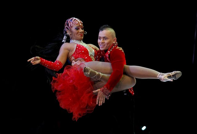 Colombian dancers Ingrid Manzano and Yelber Londono participate in an exhibition dance during the 10th World Salsa Festival in Cali, Colombia, October 4, 2015. (Photo by Jaime Saldarriaga/Reuters)