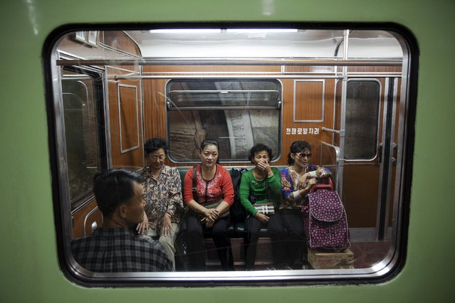 Passengers react inside a train that stopped at a subway station visited by foreign reporters during a government organised tour in Pyongyang, North Korea, October 9, 2015. (Photo by Damir Sagolj/Reuters)
