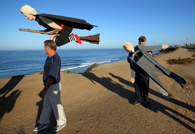 Remote control plane builder Otto Diefffenbach III  (L) gets some help as he prepares to launch his planes resembling U.S. Presidential candidates Donald Trump and Hillary Clinton in Carlsbad, California, U.S. September 15, 2016. (Photo by Mike Blake/Reuters)