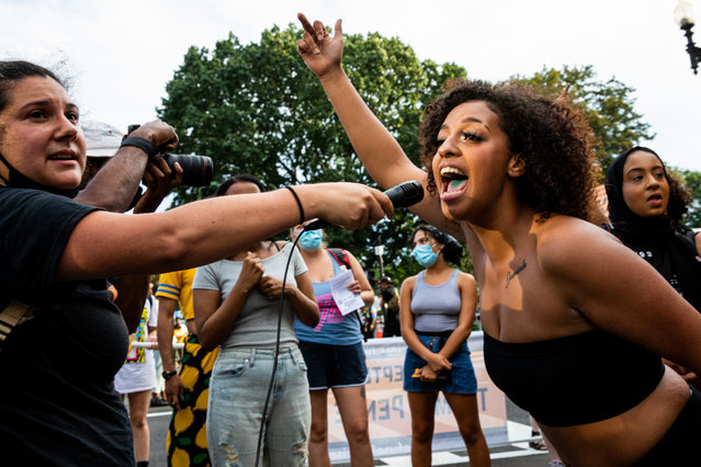 A protester leads a chant during a protest at Black Lives Matter Plaza on August 27, 2020 in Washington, DC. Protesters gathered on the final night of the Republican National Convention in which both President Donald Trump Vice President Mike Pence accepted the Republican nomination as candidates for a second term as U.S. President. (Photo by Natasha Moustache/Getty Images)