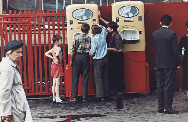 Children at a soda machine in Moscow, Soviet Union, 1950s. (Photo by Dmitry Baltermants)