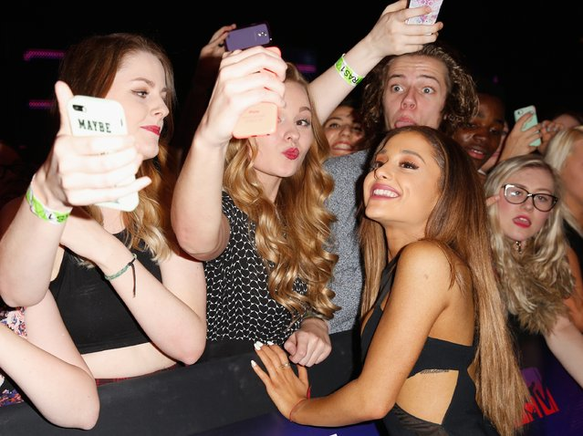 Ariana Grande poses for a selfie with fans as she attends the MTV EMA's 2014 at The Hydro on November 9, 2014 in Glasgow, Scotland. (Photo by Tristan Fewings/Getty Images for MTV)