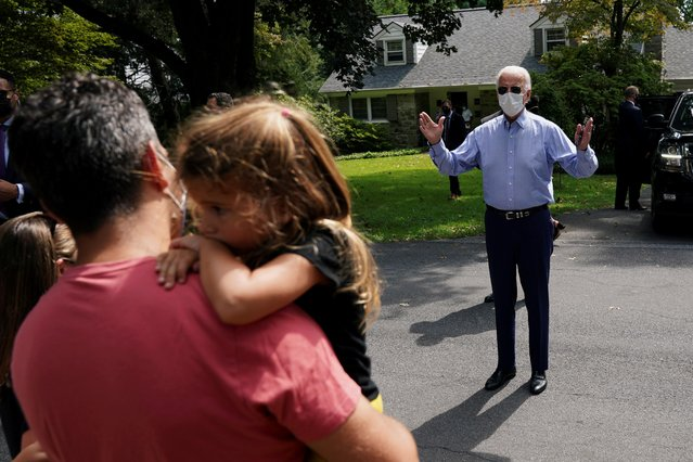 Democratic U.S. presidential nominee Joe Biden speaks to supporters on the street in a neighbourhood in Lancaster, Pennsylvania, U.S., September 7, 2020. (Photo by Kevin Lamarque/Reuters)