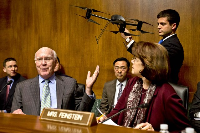 Senate Judiciary Committee Chairman Senator Patrick Leahy, speaks with an example of a drone held by a staff member during the committee's hearing to examine the future of drones in America, focusing on law enforcement and privacy considerations, on March 20, 2013. (Photo by Jacquelyn Martin/Associated Press)