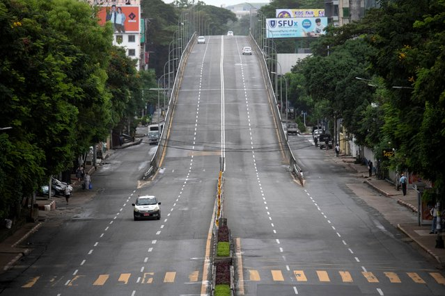 A view of a near-empty road amid the COVID-19 pandemic after authorities announced a stay-at-home order, in downtown Yangon, Myanmar on September 21, 2020. (Photo by Shew Paw Mya Tin/Reuters)