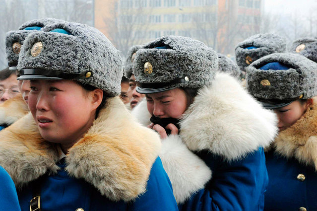 North Korean traffic control women weep for deceased leader Kim Jong Il in Pyongyang in this photo taken by Kyodo on December 21, 2011. (Photo by Reuters/Kyodo)