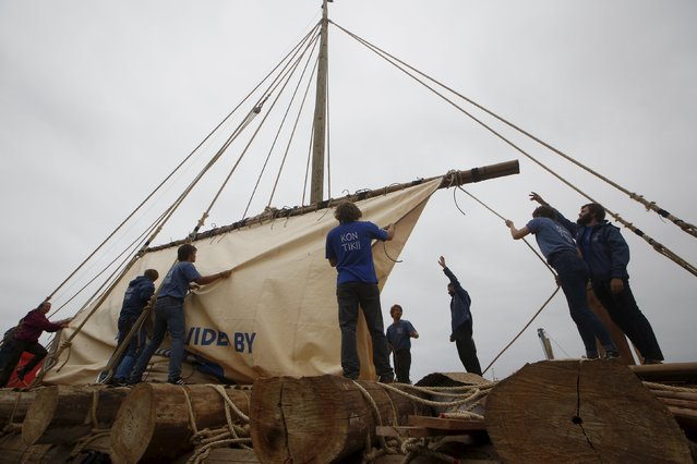 Crew members of the Kon-Tiki II expedition check out the deck of a wooden raft  prior to depart to Pascua island in Chile, at Callao port in Peru, October 30, 2015. (Photo by Mariana Bazo/Reuters)