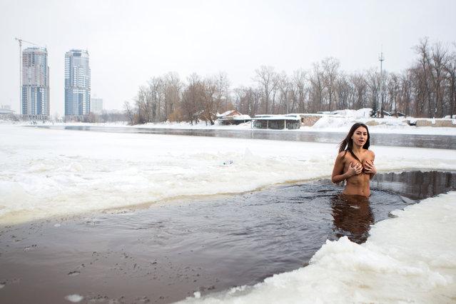Inna Vladimirskaya, 32, from Kiev, Ukraine in the Dnieper river,Kiev, Ukraine in minus temperatures as she believes it will improve her health. (Photo by David Tesinsky/Caters News Agency)
