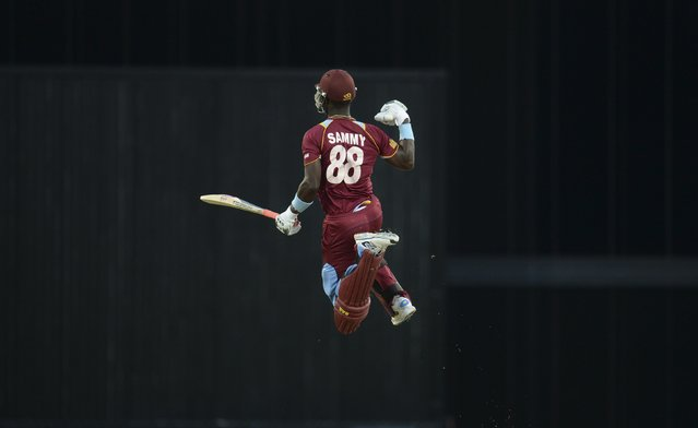 West Indies' Darren Sammy leaps to celebrate after the West Indies won their second T20 international cricket match against England at Kensington Oval in Bridgetown, Barbados in this March 11, 2014 file photo. (Photo by Philip Brown/Reuters)