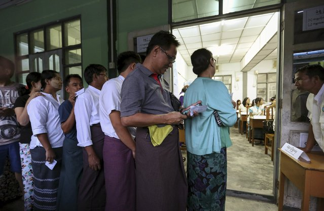People line up to cast their votes for the general election at a polling station in Yangon November 8, 2015. Voting began on Sunday in Myanmar's first free nationwide election in 25 years, the Southeast Asian nation's biggest stride yet in a journey to democracy from dictatorship. (Photo by Soe Zeya Tun/Reuters)