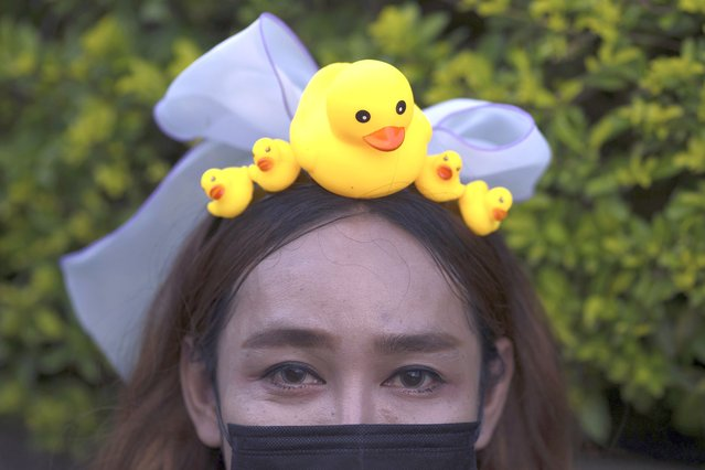 A protester wears a head band designed with yellow ducks, which have become good-humored symbols of resistance during anti-government rallies, on Wednesday, November 25, 2020, in Bangkok Thailand. (Photo by Wason Wanichakorn/AP Photo)