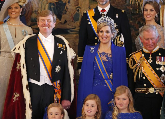 Dutch King Willem-Alexander his wife Queen Maxima accompanied by their daughters (bottom row R to L) Crown Princess Catharina-Amalia, Princess Ariane, Princess Alexia, Spain's Princess Letizia (top R) and Prince Charles of Wales (R) pose during a photocall at the royal palace in Amsterdam following the crowning cerimonies April 30, 2013. The Netherlands is celebrating Queen's Day on Tuesday, which also marks the abdication of Queen Beatrix and the investiture of her eldest son Willem-Alexander. (Photo by Bart Matt/Reuters)