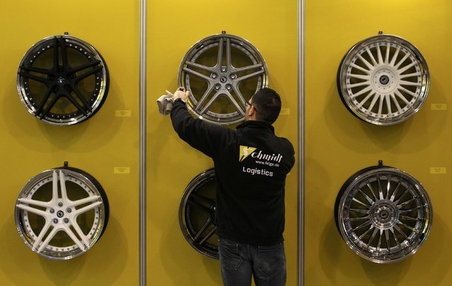 A show particpant cleans car rims displayed at the Essen Motor Show in Essen, Germany, November 27, 2015. (Photo by Ina Fassbender/Reuters)