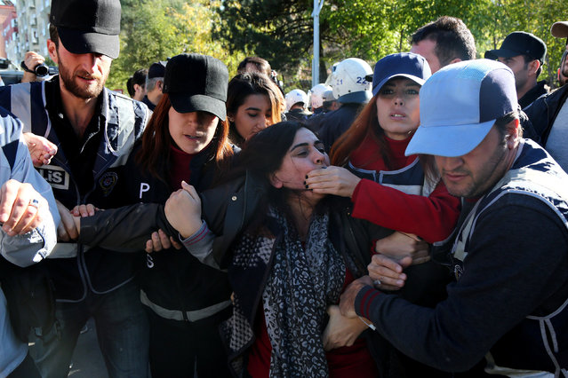 Police detain Sebahat Tuncel, co-chair of the pro-Kurdish Democratic Regions Party (DBP), during a protest against the arrest of Kurdish lawmakers, in the southeastern city of Diyarbakir, Turkey, November 4, 2016. (Photo by Sertac Kayar/Reuters)