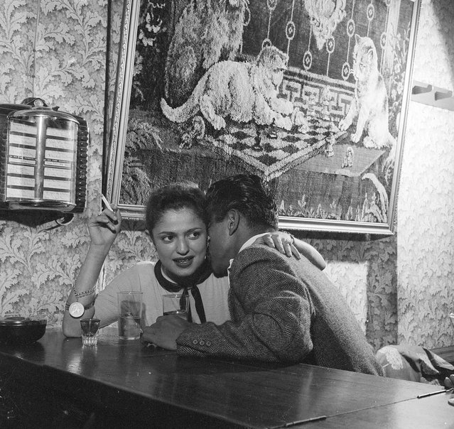 1956:  A client gets acquainted with a prostitute at a bar in Guatemala City, capital of Guatemala.  (Photo by Evans/Three Lions/Getty Images)