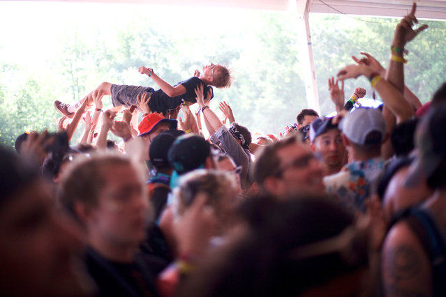 A reveler crowd surfs while The Regrettes perform on the second day in Dover, Delaware June 15, 2018. (Photo by Mark Makela/Reuters)