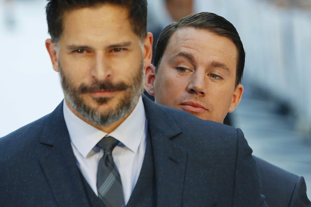 """Channing Tatum photo-bombs Joe Manganiello as he poses at the European premiere of """"Magic Mike XXL"""" at Leicester Square in London, June 30, 2015. (Photo by Luke MacGregor/Reuters)"""