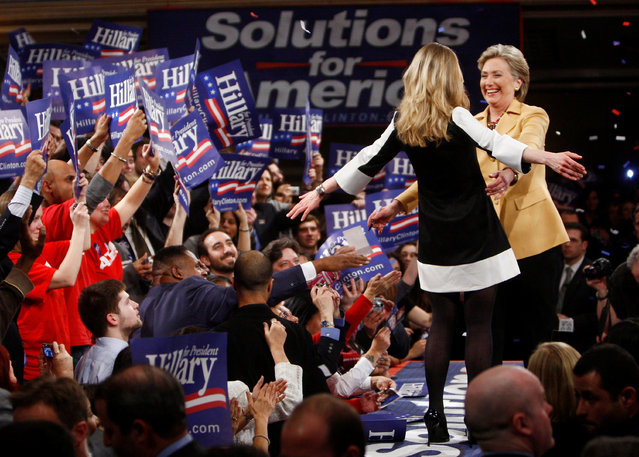 """US Democratic presidential candidate Senator Hillary Clinton (D-NY) hugs her daughter Chelsea (L) amongst supporters at her """"Super Tuesday"""" primary election night rally in New York, February 5, 2008. (Photo by Jim Young/Reuters)"""