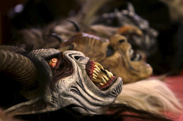 Masks of the devil lies on a table before a Krampus show in the southern Bohemian town of Kaplice, December 12, 2015. (Photo by David W. Cerny/Reuters)