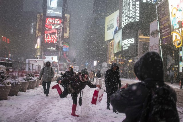 Lulu Marin, visitor from San Lorenzo, Paraguay, poses for photographs during a snow storm in Times Square, New York January 26, 2015. (Photo by Adrees Latif/Reuters)
