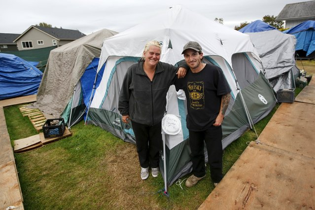 Shane Savage, 41, and his partner Jammie Nichols pose outside their tent at SHARE/WHEEL Tent City 3 outside Seattle, Washington October 12, 2015. (Photo by Shannon Stapleton/Reuters)