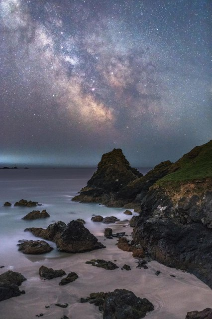 On a family trip to Cornwall after visiting Kynance Cove, on the Lizard Peninsula, the beautiful landscape seemed to be the ideal place for the photographer to capture the glimmering stars and the striking colours of the Milky Way illuminating the beautiful rocky coastline. (Photo by Ainsley Bennett/Astronomy Photographer of the Year 2018)