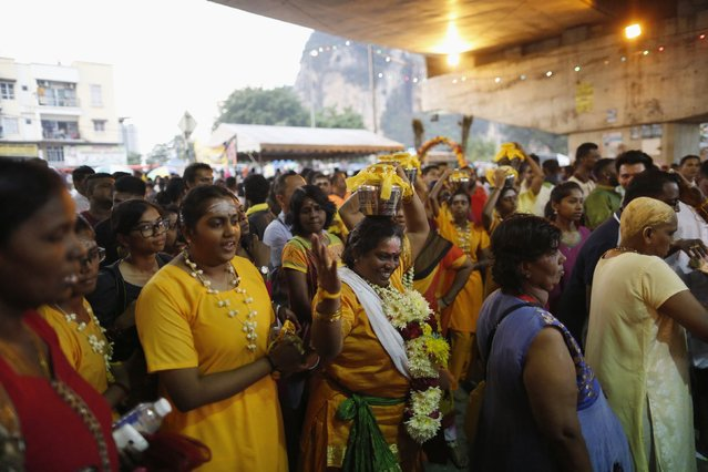 A family of Hindu devotees sing before starting their pilgrimage to the Batu Caves temple during Thaipusam in Kuala Lumpur February 2, 2015. (Photo by Olivia Harris/Reuters)