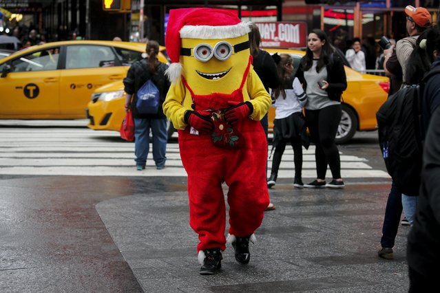 A Minion character dressed in a Christmas theme is pictured in Times Square during unseasonably warm weather on Christmas Eve in the Manhattan borough of New York, December 24, 2015. (Photo by Carlo Allegri/Reuters)