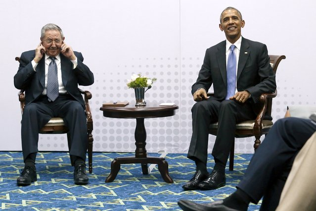 Cuba's President Raul Castro pretends not to hear questions from journalists as he and U.S. President Barack Obama hold a bilateral meeting during the Summit of the Americas in Panama City, Panama April 11, 2015. (Photo by Jonathan Ernst/Reuters)