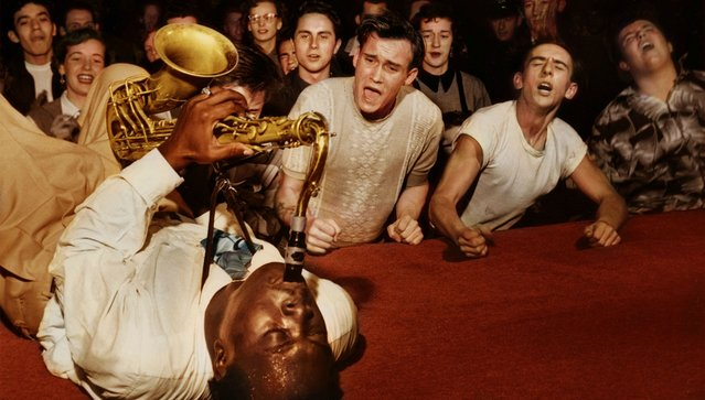 Big Jay McNeely driving the crowd at the Olympic Auditorium into a frenzy, Los Angeles, 1953. Colorized by traquea on Reddit. (Photo by Bob Willoughby)
