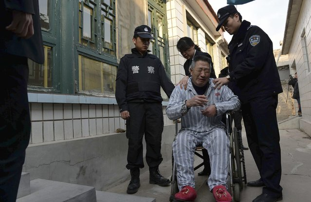 A man cries in front of his home as policemen enforce a court order to remove him from a hospital in Beijing February 10, 2015. (Photo by Reuters/Stringer)