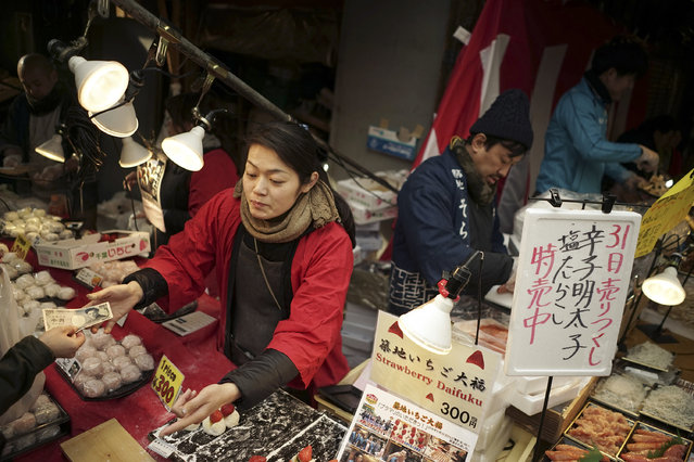 """Venders sell ingredients for """"osechi"""" or Japanese traditional New Year dishes, near Tsukiji fish market in Tokyo, Thursday, December 31, 2015. (Photo by Eugene Hoshiko/AP Photo)"""