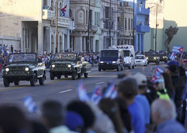 Military vehicles transport the ashes of Cuba's late President Fidel Castro at the start of a three-day journey to the eastern city of Santiago, in Havana, Cuba, November 30, 2016. (Photo by Alexandre Meneghini/Reuters)