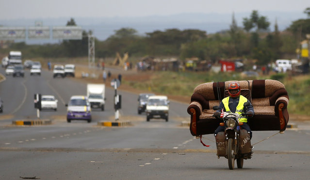 A man carries a sofa on his motorcycle on a highway near Kenya's capital Nairobi March 10, 2013. (Photo by Marko Djurica/Reuters)