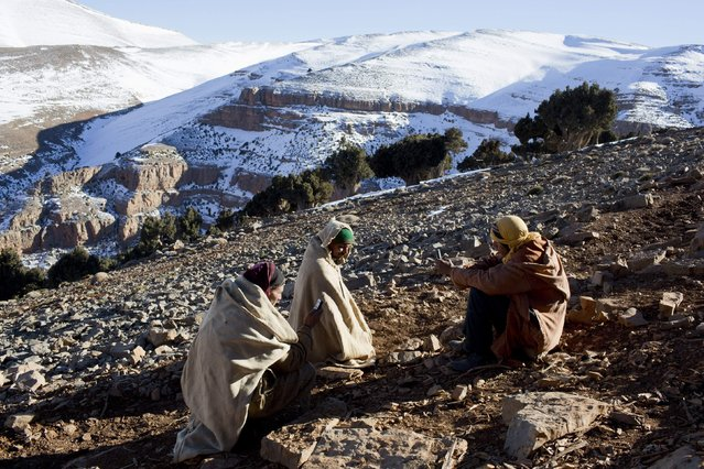 Villagers use their phones to look for a network signal at Ait Sghir village in the High Atlas region of Morocco February 14, 2015. (Photo by Youssef Boudlal/Reuters)