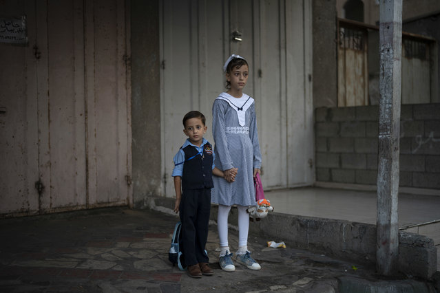 Children wait outside an UNRWA school before attending first day of class in Gaza City, Wednesday, August 29, 2018. Hundreds of thousands of Palestinian children are starting their schoolyear in the Gaza Strip amid a major budget crunch for the United Nations agency that funds many schools. (Photo by Felipe Dana/AP Photo)