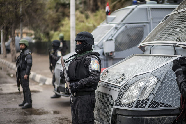 Policemen stand guard as they patrol a street on Police Day, which is also the anniversary of the 2011 uprising, in Tahrir Square, in the Haram district of Cairo, Egypt, Monday, January 25, 2016. The uprising failed to bring about the goals of democracy and freedom the pro-democracy youths who spearheaded the 'revolution' had espoused. The run-up to the anniversary has seen stepped-up security measures as well as a new wave of arrests and security checks in downtown. (Photo by AP Photo/Stringer)