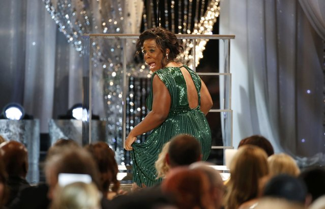 """Uzo Aduba reacts as she takes the stage to accept the award for Outstanding Performance by a Female Actor in a Comedy Series for her role in """"Orange is the New Black"""" at the 22nd Screen Actors Guild Awards in Los Angeles, California January 30, 2016. (Photo by Lucy Nicholson/Reuters)"""