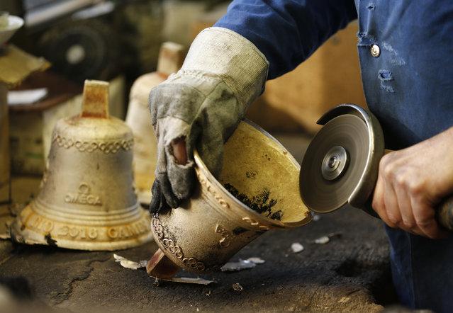 Serge Huguenin of the Blondeau foundry prepares a bronze bell in La Chaux-de-Fond, Switzerland January 21, 2016. (Photo by Denis Balibouse/Reuters)