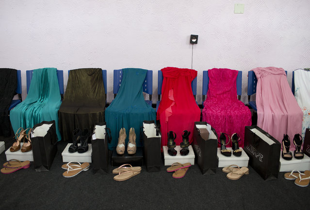 Gowns and shoes are laid out for female inmates who are competing in the 13th annual Miss Talavera Bruce beauty pageant, the namesake of the female prison in western Rio de Janeiro, Brazil, Tuesday, December 4, 2018. For a day, about a dozen women serving time at the penitentiary swap their uniforms for gowns. The clothes the contestants compete in are on loan from a local business. (Photo by Silvia Izquierdo/AP Photo)