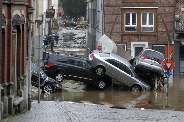 Cars are piled up as flooding affects the area after heavy rains in Ensival, Verviers, Belgium, 15 July 2021. Heavy rains have caused widespread damage and flooding in parts of Belgium. (Photo by Stephanie Lecocq/EPA/EFE/Rex Features/Shutterstock)