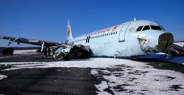"""This photo provided by the Transportation Safety Board of Canada shows a Air Canada Airbus A-320 at Halifax International Airport after making an """"abrupt"""" landing and skidding off the runway in bad weather early Sunday, March 29, 2015. Officials said 23 people were taken to a hospital for observation and treatment of minor injuries, none of which were considered life threatening. (Photo by AP Photo/The Transportation Safety Board of Canada)"""