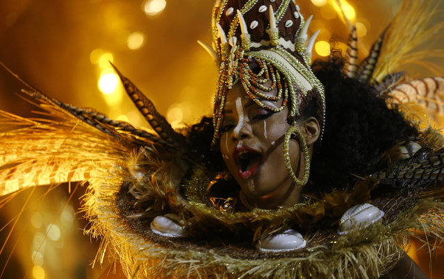 A reveller of the Mangueira samba school performs during the carnival parade at the Sambadrome in Rio de Janeiro, February 9, 2016. (Photo by Pilar Olivares/Reuters)