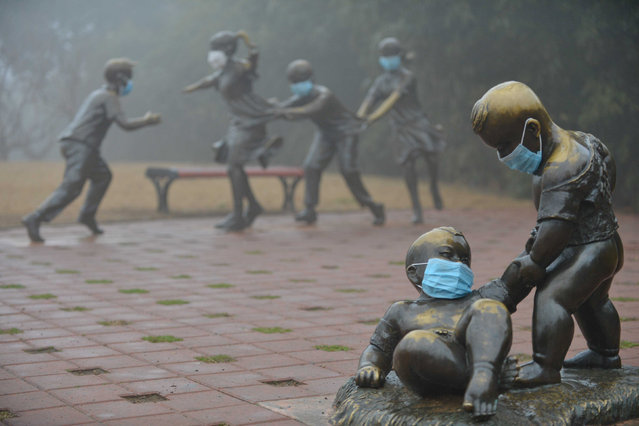 Masks are pictured on sculptures in a park during a hazy day in Puyang, Henan province, China January 4, 2017. (Photo by Reuters/Stringer)